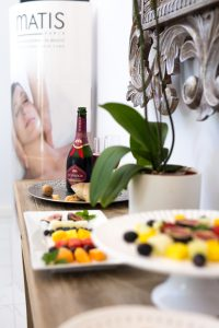 Exclusive beauty care face with champagne and snacks